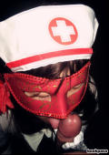 Japanese chick in kinky masked nurse costume.