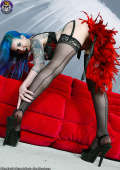 Tempting Tattooed Seductress Teasing in Heels and Stockings