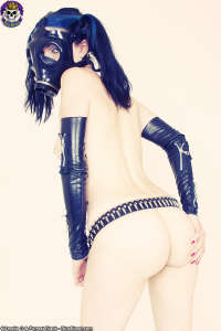 Scary pale Goth girl in kinky gasmask